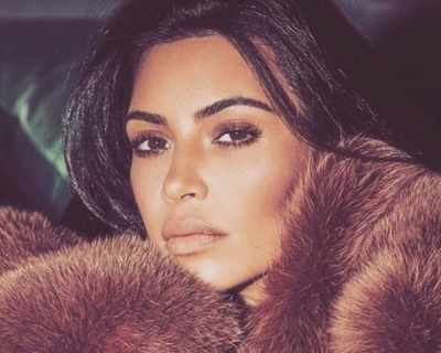 Ким Кардашян замени любимите си кожени палта с ...
